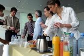 foto of matinee  - Men and women having a drink at work - JPG