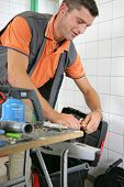 Portrait of a man with a blowtorch and a toolbox poster
