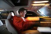Man Driving Car At Night