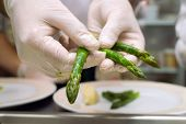 preparation of an asparagus on kitchen at restaurant