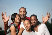 stock photo of father time  - Happy African American family - JPG