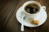 Coffee over wooden background