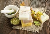 Handmade Soap with natural ingredients over wooden background