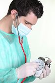 Nurse examining a clock