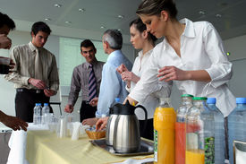 stock photo of matinee  - Men and women having a drink at work - JPG