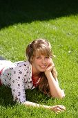 Pretty Teen Girl Lying In Grass