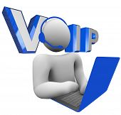 The word acronym VOIP or V.O.I.P. illustrated behind a person talking to someone via his laptop comp