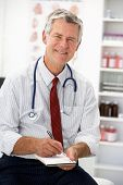picture of prescription pad  - Senior doctor writing prescription - JPG