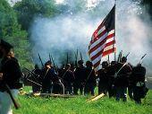 image of yanks  - Union line preparing to fire  Civil War battle reenactment  - JPG
