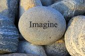 image of reinforcing  - Positive reinforcement word imagine engrained on a rock - JPG