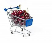 metal shopping trolley filled with cherry
