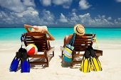 Happy family vacation at Paradise. Couple relax on the white sand of beach. Happy sea lifestyle. You poster