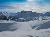 Ski Slopes On Sunny Day In Austrian Alps