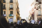 Massive Protest In The Street With Everything Out Of Focus Except The Blank Banners To Be Able To En poster