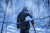 Man In Camouflage Alone In The Winter Forest At Night He Holds In His Hand A Sapper Shovel Around Fa poster