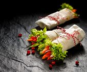 Vegan Tortilla Wraps  Stuffed With Hummus And Fresh Vegetables On A Black Stone Background poster