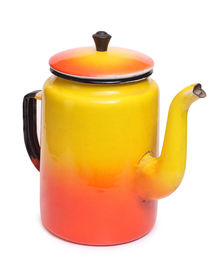 pic of kitchen utensils  - Color photo of an old metal coffee pot - JPG