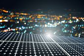 Texture Of Photovoltaic Panels Solar Panel With City Bokeh Light Night Background, Alternative Energ poster