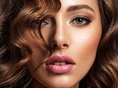 Beautiful woman with brown hair. Beautiful face of an attractive model with fashion makeup. Woman wi poster