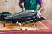 Male Worker At The Fish Market In Male, Maldives, Cutting A Big Tuna Fish poster