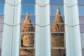 Matthias Church Reflection. Fisherman Bastion With Details On The Facade And The Whole Scene Of The poster