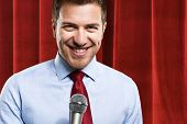stock photo of public speaking  - Portrait of a man speaking in a microphone - JPG