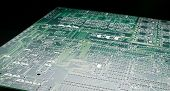 pic of pnp  - Printed circuit board with high contrast lighting and black background - JPG