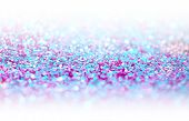 Ultraviolet glitter shine dots confetti. Abstract light blur blink sparkle defocus backgound. poster