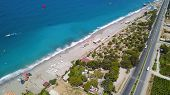 Top View Of City Beach With Beautiful Blue Ocean Water. Stock Footage. Highway Runs Along Coast Near poster