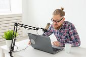 Radio, Dj, Blogging And People Concept - Smiling Man Sitting In Front Of Microphone, Host At Radio poster
