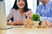 European And Asian Couples Are Buying A House And Entering Into A House Purchase Contract,people Are poster