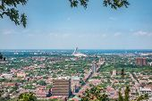Montreal city summer view of Stadium from top of Mount Royal, neighborhood background. Mobile pictur poster