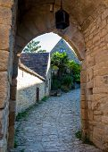 Typical French Townscape With Ancient Housest And Cobblestone Street In The Traditional Town Beynac- poster