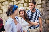 Happy Group Of Tourists Traveling And Sightseeing poster
