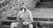 Man Bearded Enjoy Quick Snack And Drink Paper Cup. Street Food So Good. Urban Lifestyle Nutrition. C poster