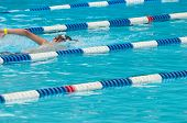 Non-Identifiable Swimmer In Outdoor Swimming Pool
