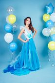 Happy Girl In Prom With Helium Air White, Blue And Yellow Balloons. Portrait Of A Beautiful Woman In poster