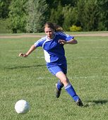 Youth Teen Soccer Player Running After Ball 2