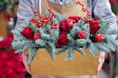 Winter Decor. Beautiful Flower Arrangement Of Red Roses, Natural Sprigs Of Blue Spruce And Christmas poster