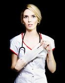 Serious Young Nurse Removing Her Latex Gloves