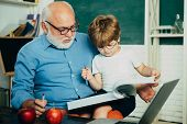 Happy Cute Clever Boy And Old Tutor With Book. Funny Little Child Having Fun On Blackboard Backgroun poster