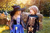 Children In America Celebrate Halloween. Happy Kids On Halloween Party. Trick-or-treating. Cute Chil poster