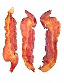 Three cooked, crispy fried bacon isolated on a white background.  Good for many health and cooking i