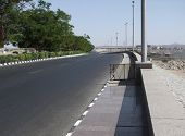 pic of aswan dam  - sunny scenery showing a road on the Aswan dam in Egypt - JPG