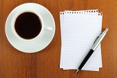 Cup of coffee paper and pen