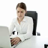 Young Brunette Woman Is Uncertain On Her Desk