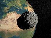 stock photo of meteorite  - Bog grey meteorite going to earth in universe full of stars - JPG
