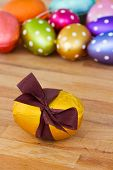 golden easter egg on wooden table