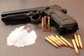foto of rock cocaine  - concept of a drug deal or gun hire going down against a dark background - JPG