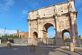 Famous Arch of Constantine aka triumphal arch and Santa Francesca Romana church on Palatine hill in